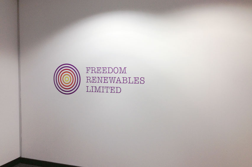Multi Coloured Vinyl Logo. Applied directly to office recpetion wall.